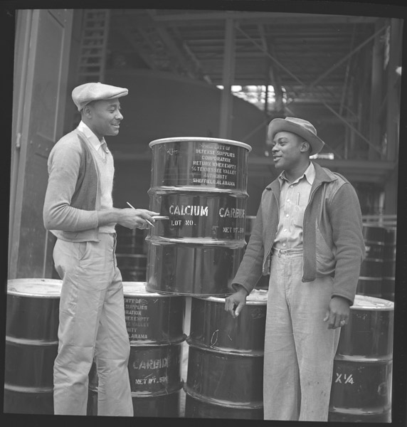 Men Near Fertilizer Drums