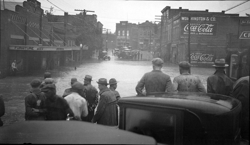 Men Looking At Flooded Town
