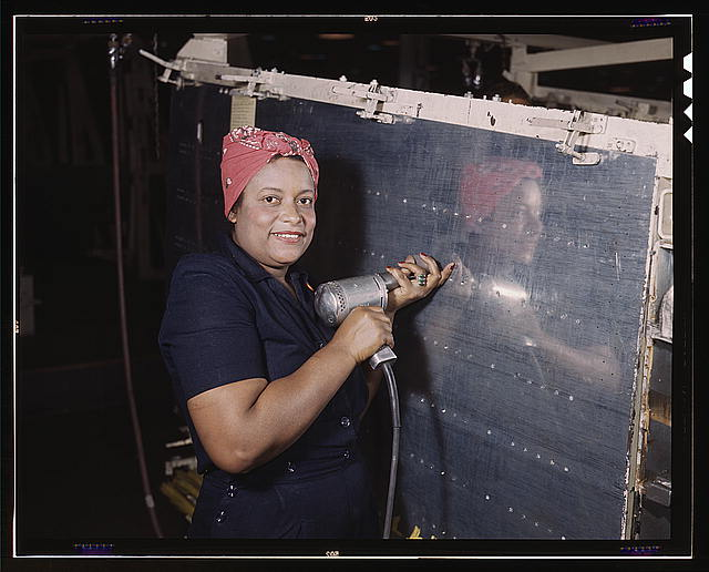 Woman Working On A Bomber