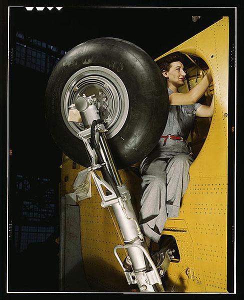 Woman Working On Bomber Landing Gear