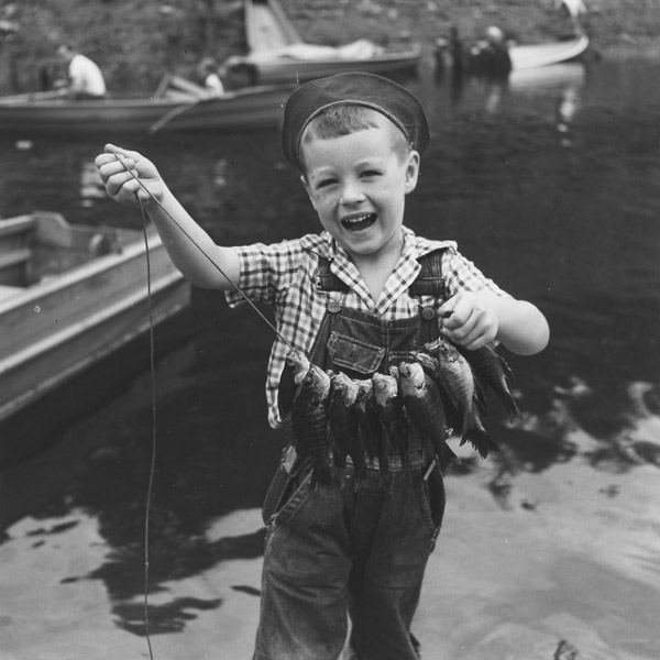 Boy With String of Fish